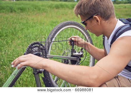 Cyclist Checks Chain