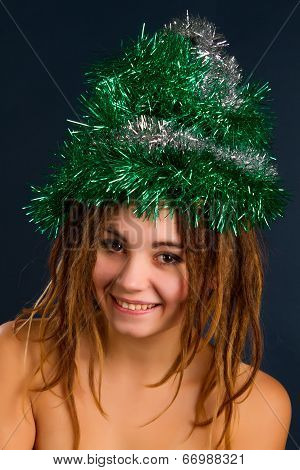 Woman With Dreadlocks Against A Dark Background