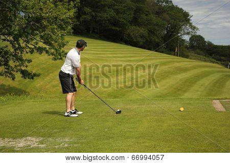 Playing golf