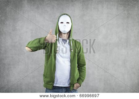 Young Boy In A Mask With A Thumb Up