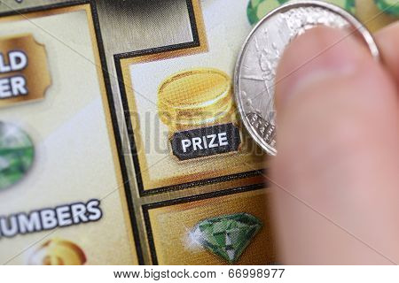 Coquitlam BC Canada - June 15, 2014 : Woman scratching lottery ticket called lucky 7. It's published by BC Lottery Corporation has provided government sanctioned lottery games.