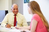 image of 15 year old  - Female Student Talking To High School Counselor - JPG