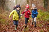 stock photo of 7-year-old  - Family Walking Through Winter Woodland - JPG