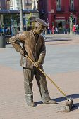 image of sweeper  - Bronze Street sweeper monument in a street of Madrid