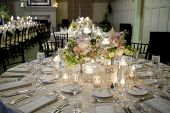 stock photo of opulence  - elegant table setting for wedding reception with bouquets - JPG