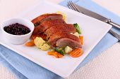 stock photo of duck breast  - Roasted duck breast with vegetables wild blueberries close up - JPG