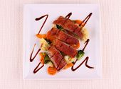 image of duck breast  - Roasted duck breast vegetables black sauce top view - JPG