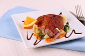 stock photo of duck breast  - Roasted duck breast fillet vegetables and orange close up - JPG