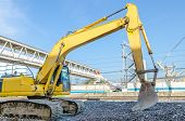 picture of backhoe  - tractor or front loader with backhoe is operating - JPG