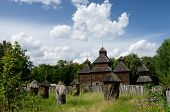 stock photo of farmworker  - Resurrection wooden church with apiary from Poltavshina region Ukraine - JPG