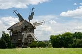 stock photo of farmworker  - Traditional old Ukrainian rural windmill - JPG