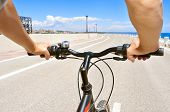foto of bike path  - closeup of a young man riding a bike on a no traffic road - JPG