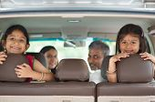 picture of sari  - Happy Indian family sitting in car smiling - JPG