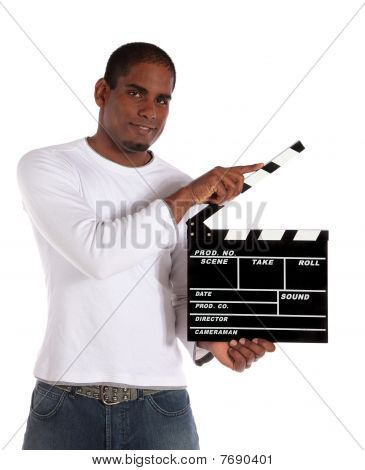 Attractive man using clapperboard