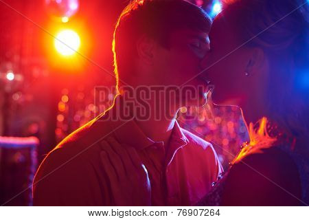 Couple dancing and kissing