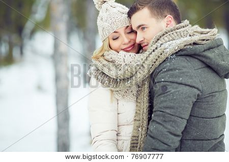 Portrait of a young couple in warm clothing