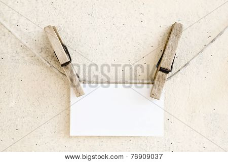 Clothespins Holding Blank White Paper Card