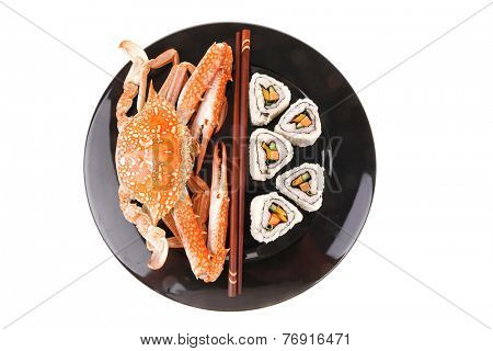 California Roll with Avocado and Salmon, Cream Cheese . on black dish with boiled crab . Japanese Traditional Cuisine