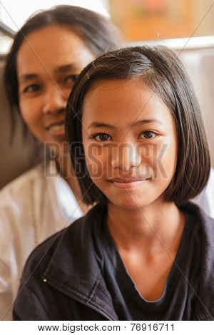 BANGKOK, THAILAND, FEBRUARY 1, 2012: Portrait of a daughter and her mother sitting in the train going from Bangkok to Ayutthaya in Thailand