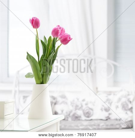 pink tulip in whit room