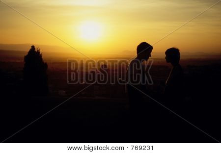 Lovers enjoys the sunset over Granada, Spain