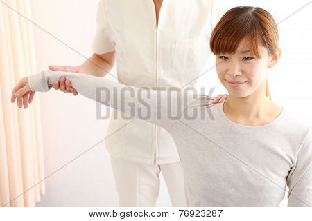 young Japanese woman getting chiropractic