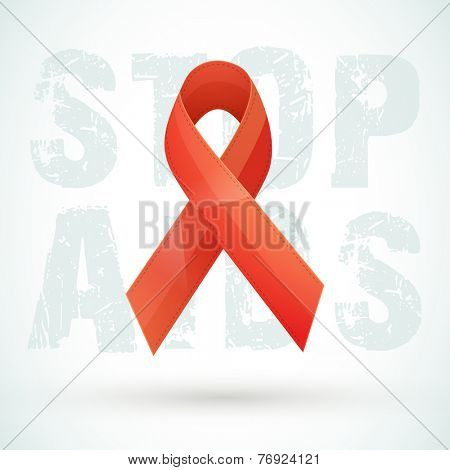 Red ribbon of aids awareness on stylish text for World Aids Day concept.