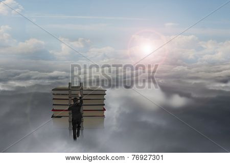 Businessman Climbing On Wooden Ladder To Top Of Books