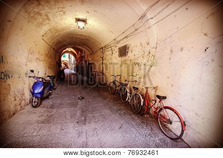 Retro Filtered Picture Of Neglected Passage With Bikes.