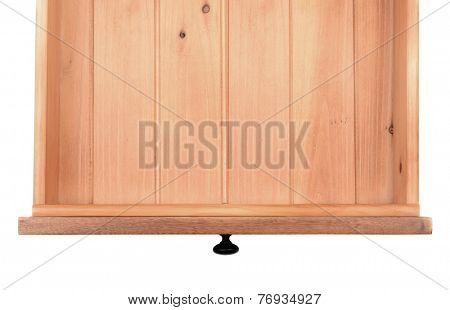 High angle of an empty kitchen or dresser drawer.  The wooden drawer is isolated on a white background and has a black metal knob.