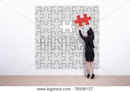 Business Woman Hold Jigsaw Puzzle