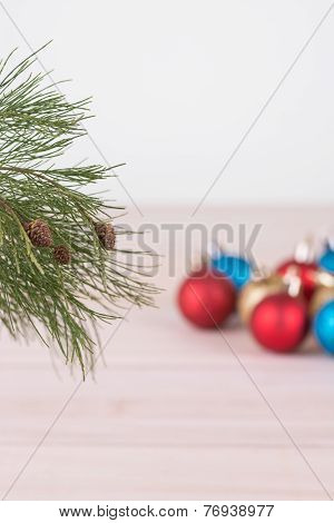 Pine Tree Branch With Colorful Christmas Baubles
