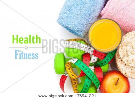 Dumbells, tape measure, healthy food and towels. Fitness and health. Isolated on white background