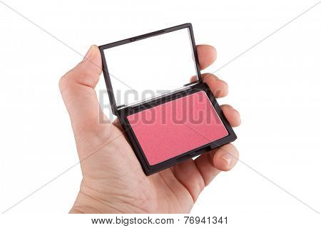 Female hand holding a red blush, isolated on white