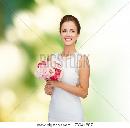 people, wedding, holidays and celebration concept - smiling bride or bridesmaid in white dress with bouquet of flowers over green background