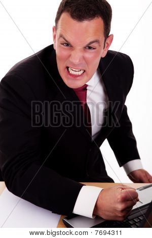 Portrait Of A Angry  Business Man Isolated On White Background. Studio Shot.