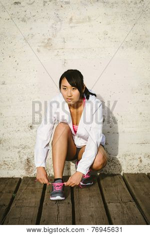 Asian Woman Getting Ready For Running