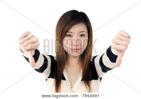 Attractive Woman Showing Thumbs Down Sign