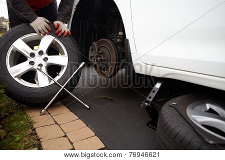 Car Mechanic Changing Tire.