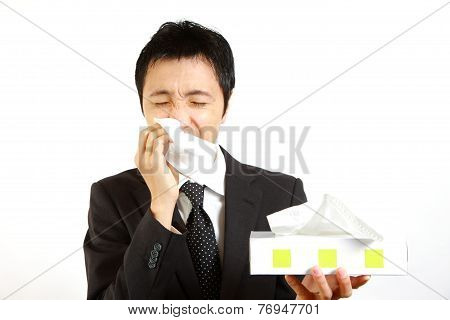 Japanese businessman suffer from a runny nose