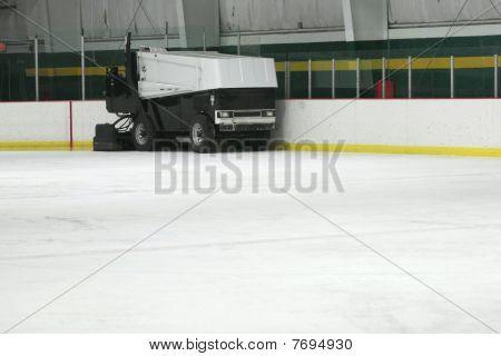 Ice Resurfacing machine smoothing ice in skating rink