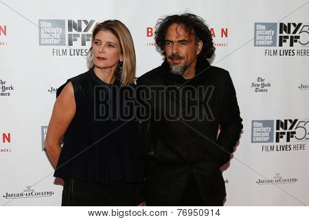 NEW YORK-OCT 11:Director Alejandro Inarritu (R) & Maria Eladia Hagerman attend 'Birdman Or The Unexpected Virtue Of Ignorance' premiere at New York Film Festival on October 11, 2014 in New York City.