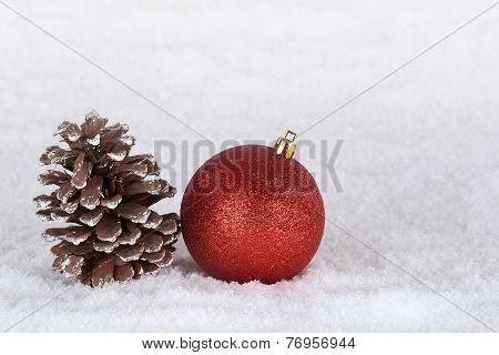 Christmas Decoration With Christmas Tree Ball, Fir Cone And Snow