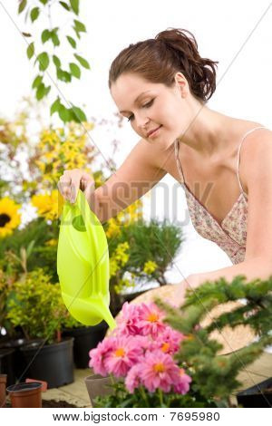 Gardening - Woman With Watering Can And Flowers