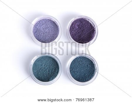 Mineral eye shadows in pastel colors, top view isolated on white background