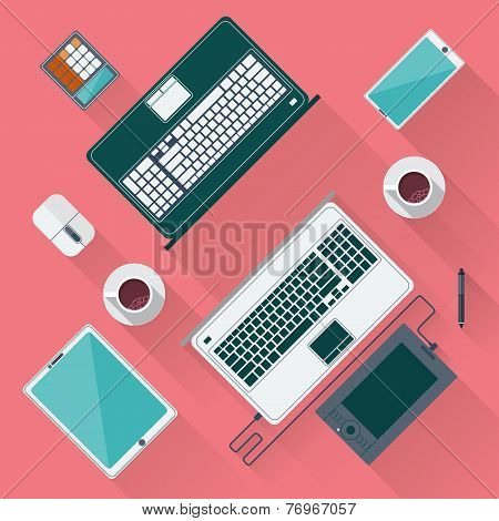 Office desk with laptop, tablet, smartphone