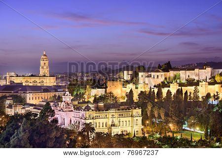 Malaga, Spain cityscape at the Cathedral, City Hall and Alcazaba Moorish fort.