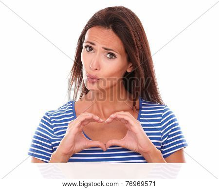 Unhappy Lady Gesturing A Heart Sign