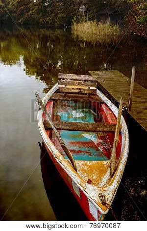 Old rowboat on a lake in autumn, Germany