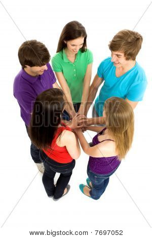 Friends stacking their hands together